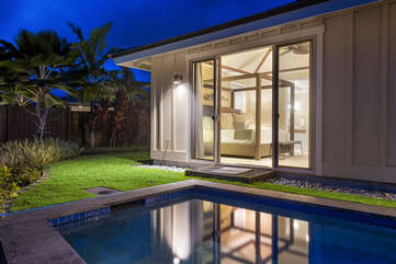 Nighttime view of the sliding glass door leading into the master bedroom.
