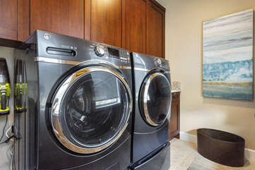 Laundry room includes full sized washer/dryer