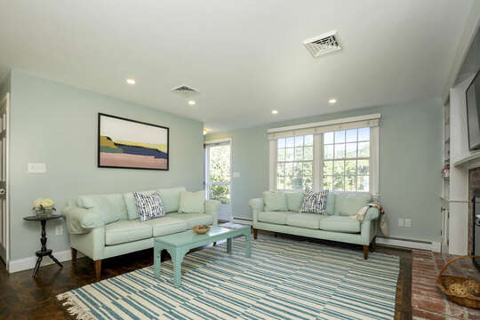 The living room's cool colors are inviting at 40 Tip Cart Chatham Cape Cod - New England Vacation Rentals