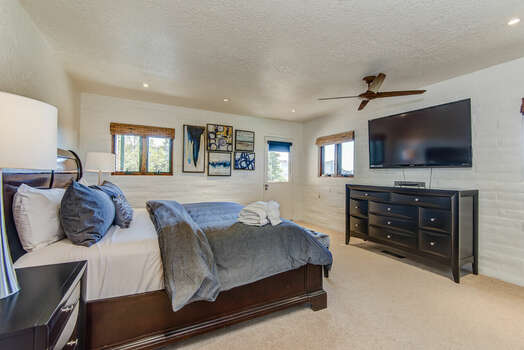 Master Bedroom with a King Bed and Deck Access