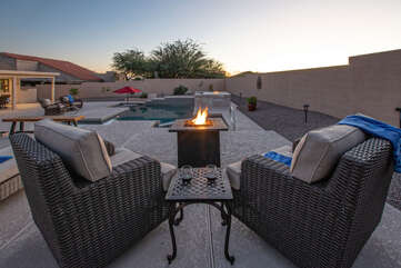 There are 2 propane fire pits to warm the air: one is a stand alone and the other is built in.
