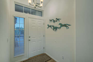 Entrance hints at home's charm and southwestern appeal.