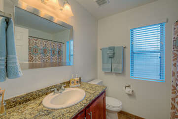 The second bath with a tub-shower combination is shared between the second and third bedrooms.