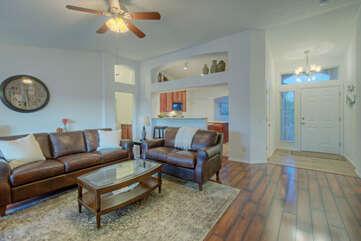 Open floor plan invites togetherness between great room and kitchen.