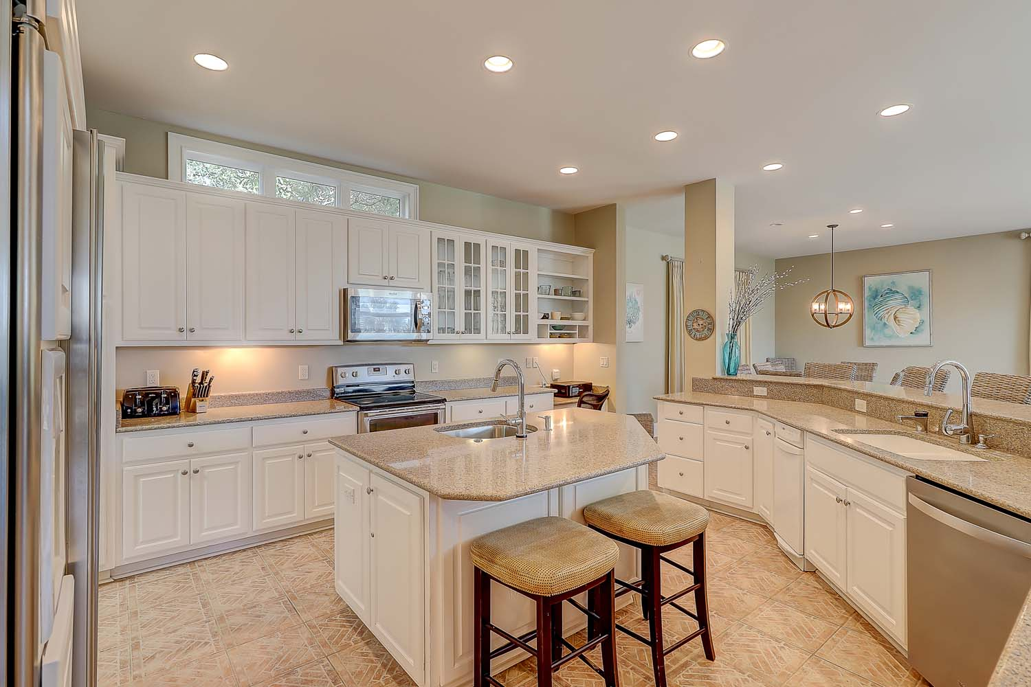 Kitchen is large, fully-equipped and has center island prep area that also seats 2. You will enjoy preparing daily meals in the hub of the first floor living space.