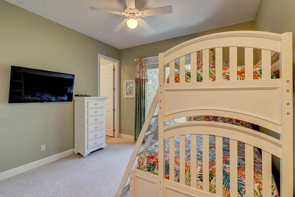 First floor bunk bed room has double bed on bottom, twin bed on top, wall-mounted flat panel TV and en-suite bathroom with stand up shower