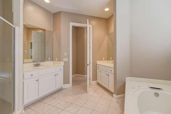 First floor master bathroom with soaking tub, dual vanities and walk in shower
