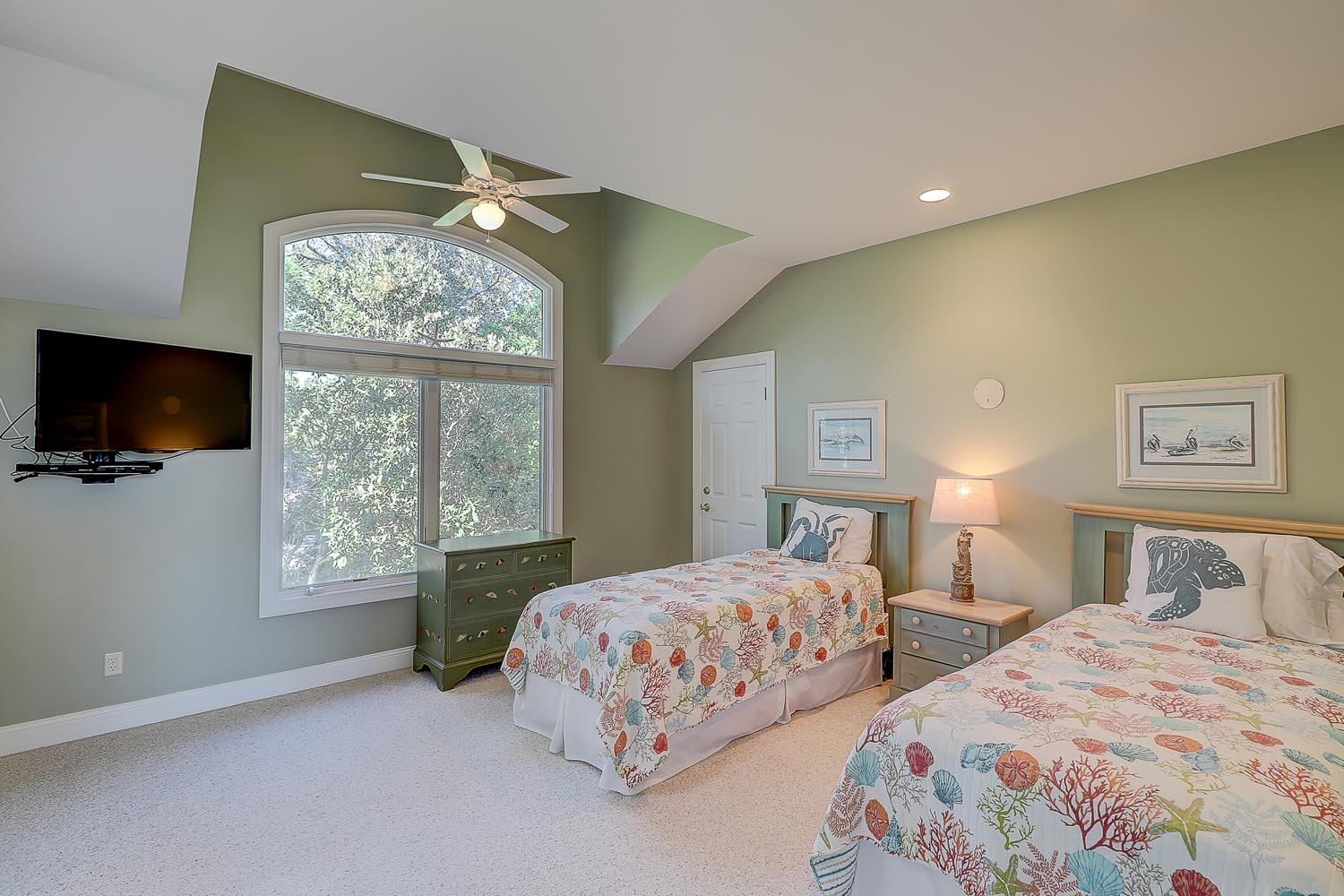Upstairs bedroom with one queen bed and one twin bed, wall-mounted flat panel TV and access to jack and jill bath shared with bedroom 5