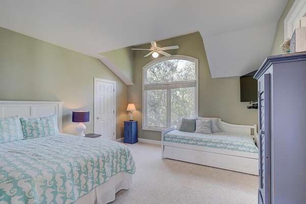 Bedroom 5 has queen bed, twin day bed with twin trundle, wall-mounted flat panel TV and access to jack and jill bathroom