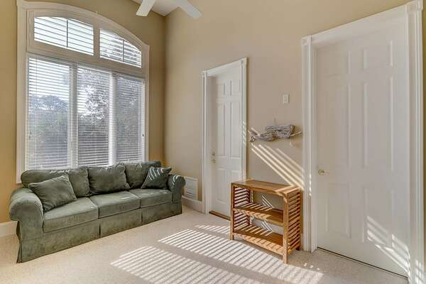 Upstairs den room has queen sleeper sofa and access to upstairs laundry room with full size washer and dryer, the second laundry room in the home