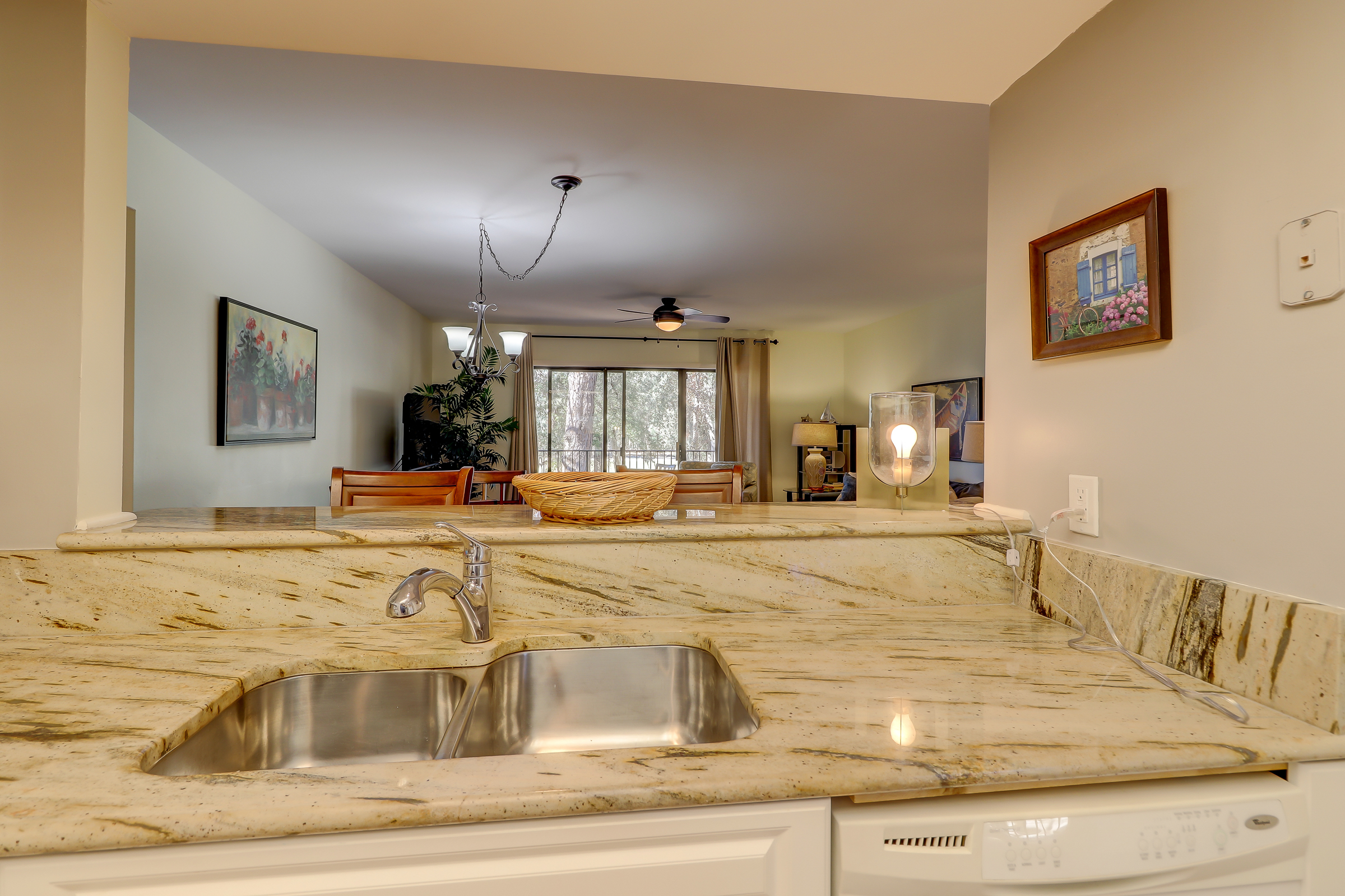 The kitchen is open to the living room and dining areas, making entertaining fun and easy