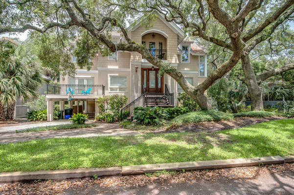 Front exterior is beautiful and has a canopy of majestic live oak trees