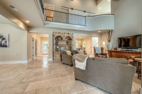 The mediterranean tile, luxurious furnishings, vaulted beamed ceilings, large wall-mounted flat panel TV and open living space greet you as you enter the home.