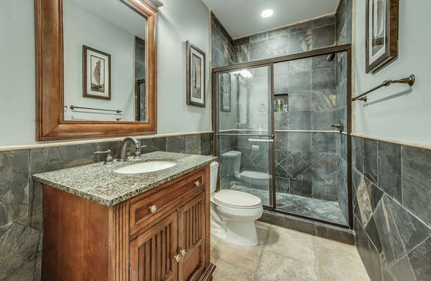 Hall bathroom that can be entered from this bedroom 3 or the hallway off the kitchen. This bathroom features a glass-enclosed walk in shower