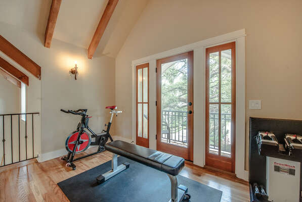 Rounding out the upper level of the home is this quiet nook, great for a quick workout or sitting on the balcony that faces the front of the home. You can hear the ocean from this balcony