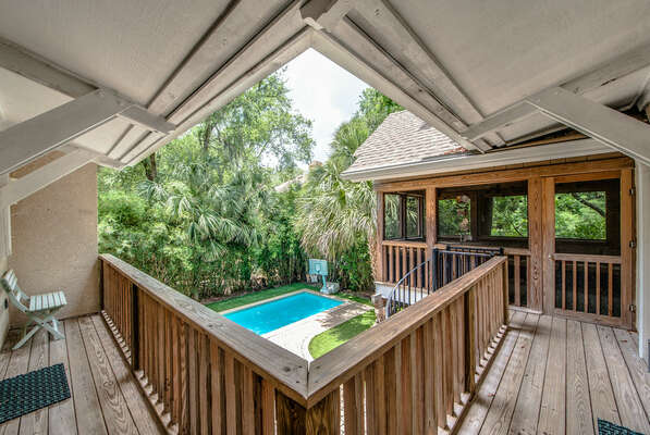 The covered back porch is a great place to relax and keep an eye on the pool
