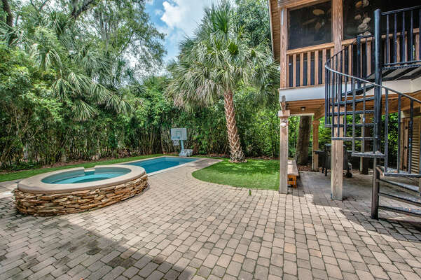 Take the spiral staircase off the screened porch down to the pool deck