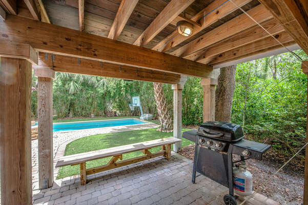 Covered deck area has outdoor shower and 3 burner gas grill