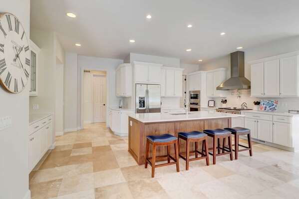The kitchen is newly renovated and has beautiful stone counters, upgraded appliances including gas Wolf range, and counter height breakfast bar with seating for 4
