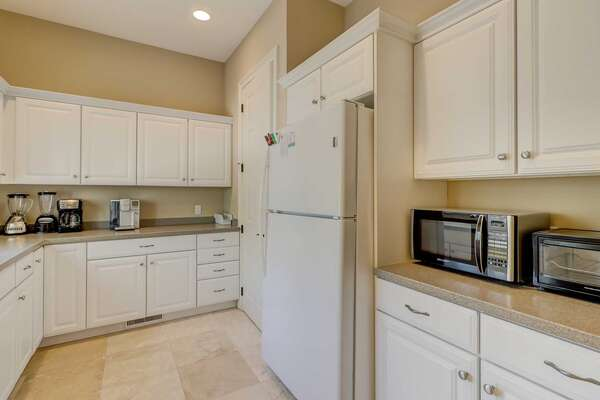 The butler's kitchen is available for additional snack prep, morning coffee stations and additional refrigerator space