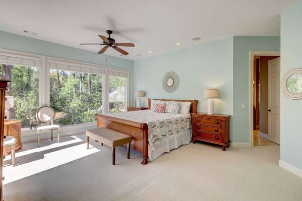 The master bedroom is located on the first level and has a king bed King Bed, flat panel smart TV, pool patio access and private en suite master bath with double vanities, soaking tub and walk in shower. Daybed in separate room off master bath. Large closet space as well.
