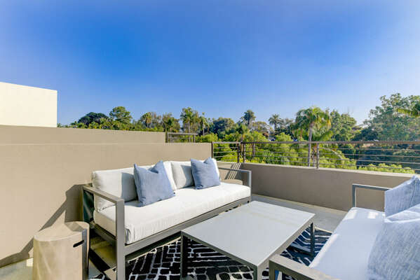 Third Level Deck with Outdoor Seating and Table at our San Diego Townhouse Rental