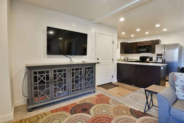 Living room with a flat-screen TV and kitchen