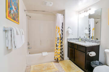 Second bathroom with a bathtub and one sink