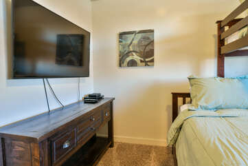 Second bedroom with a bunk bed and TV
