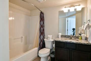 Master bathroom with a bathtub and sink