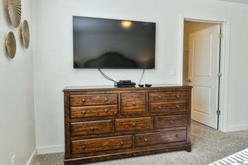 Master bedroom with a flat-screen TV