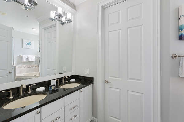 A dual vanity provides plenty of space for getting ready