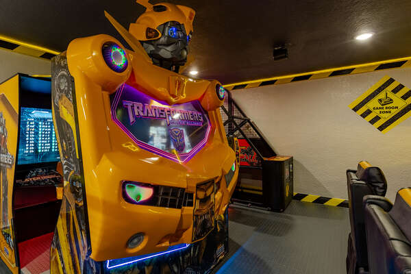 Grab a friend for a two-player game on the Transformers Human Alliance arcade