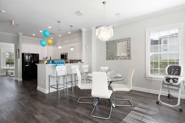 Have a snack before exploring Orlando at this dining table with seating for 4 guests