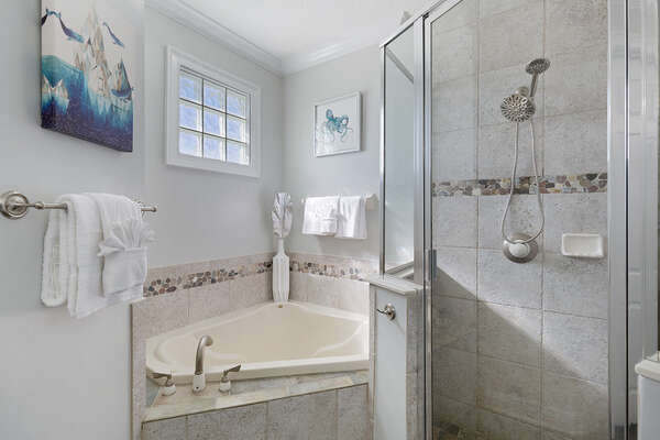 The ensuite bathroom has a beautiful garden tub and walk in shower