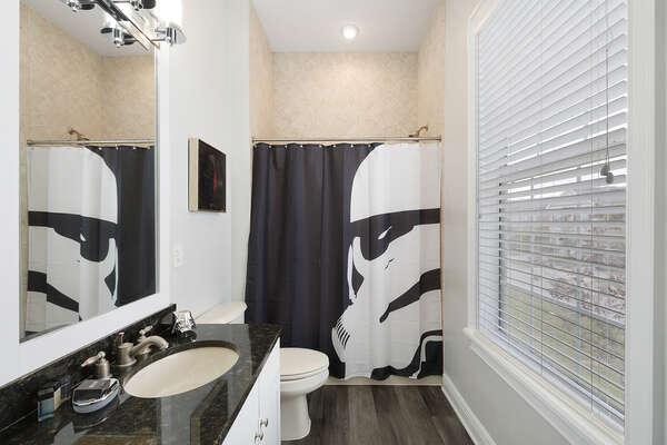 The ensuite bathroom has a shower/tub combination