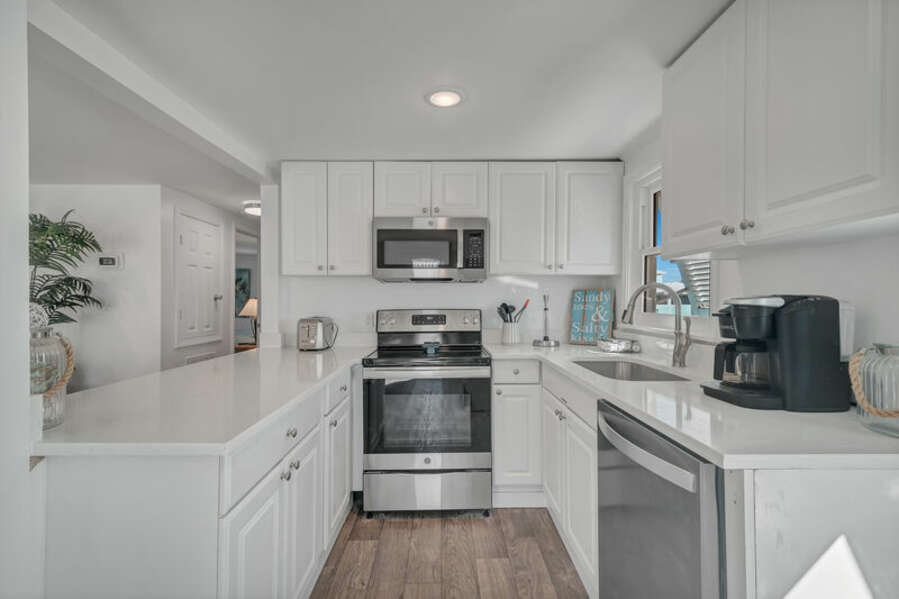 Fully Equipped Kitchen with upgraded Stainless Steel Appliances and Breakfast Bar with Additional Seating