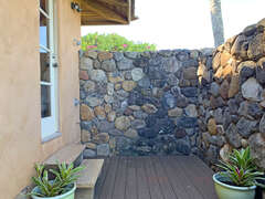 Step outdoors from the master bath into a fabulous outdoor shower with hot/cold water