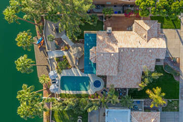 Custom Gilbert home in upscale neighborhood  is situated on a lake that is stocked for catch and release fishing.