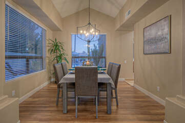 Formal dining room with new floors has large windows which maximize natural light.