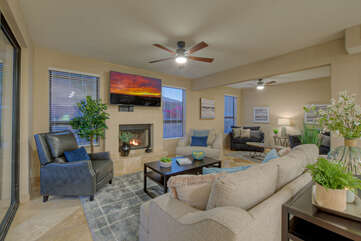 Large TV, ceiling fan, gas fireplace and 2 oversized sleeper chairs are appealing features of the cozy great room.