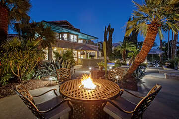 The backyard is an oasis of amenities that includes a propane fire pit for cooler evenings.