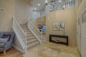 Lovely front entrance and foyer with formal living room to the left of staircase.