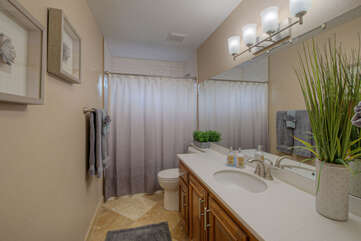 Third bathroom with a tub-shower combination is on the ground floor.