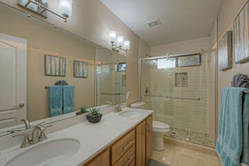 Bathroom 2 on the second floor boasts a newly remodeled walk-in shower plus dual vanity sinks.
