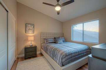 Bedroom 3 is on the second floor and features a king bed and outdoor view.