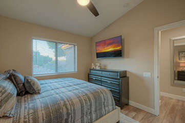 In addition to a king bed, the third bedroom has a TV and ceiling fan.
