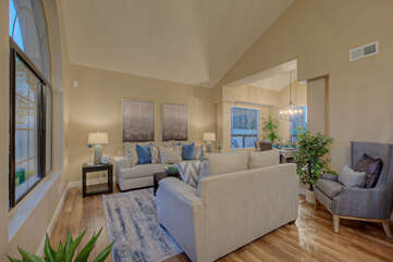 Elegant yet comfortable, living room has street and front yard views from large windows.