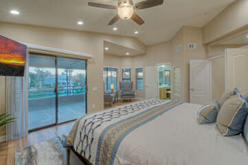 Primary suite is on the second floor and has access to a covered balcony with engaging views.