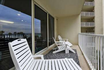 Balcony area with lounge seating and Adirondack furniture sure to help you relax